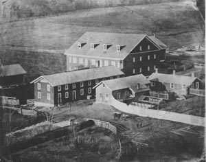 Old Main and Surrounding Barns and Shacks, pre-1897, at Penn State