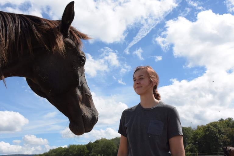 Paulina Oleinik, a senior in Penn State's College of Agricultural Sciences, is one of the live-in employees at the Penn State Horse Barn. IMAGE: PENN STATE