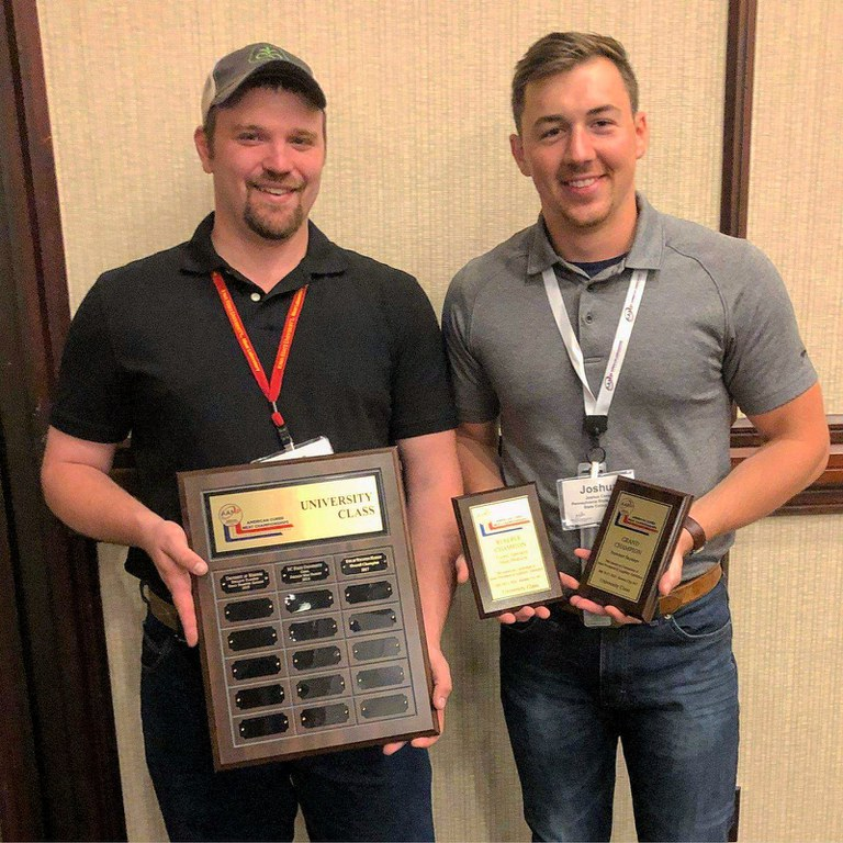 Dave Weaver, left, assistant manager of the Penn State Meat Laboratory, and Josh Cassar, graduate student, hold the trophies they won at the American Cured Meat Championship in Kansas City.