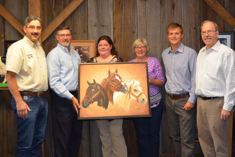 Painting of Penn State stallions on display in Penn State's Department of Animal Science. From left: Brian Egan, Joe Tylka, Artist Caitlin Walsh, Julianne Tylka, Burt Staniar and Terry Etherton.