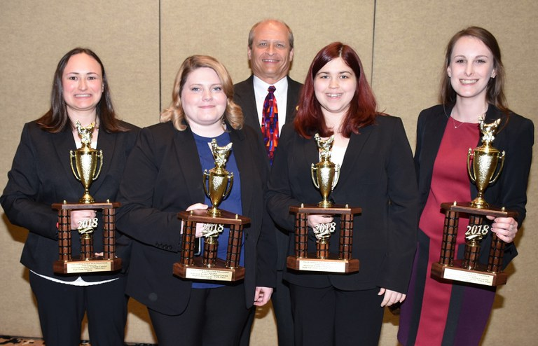 Collegiate Poultry Judging Team, from left: Heather Menges, Katie Sondericker, Coach Phillip J. Clauer, Amanda Kulp and Hannah Sciubba.