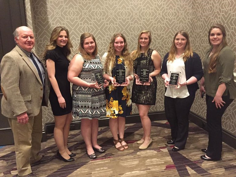 From left: Dr. Mills, Olivia Richart, Abbey Allison, Amy Middleton, Kasie Kerr, Alexa LeCrone and Megan McCunn.